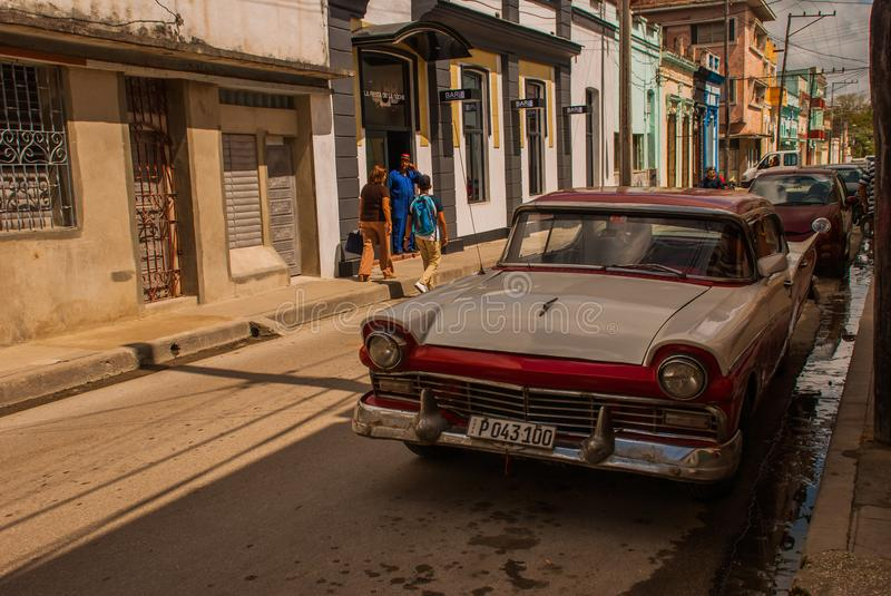 Old car on Santa Clara, Cuba. Cuba has the biggest show of old cars still cruising the streets in various conditions. stock photography