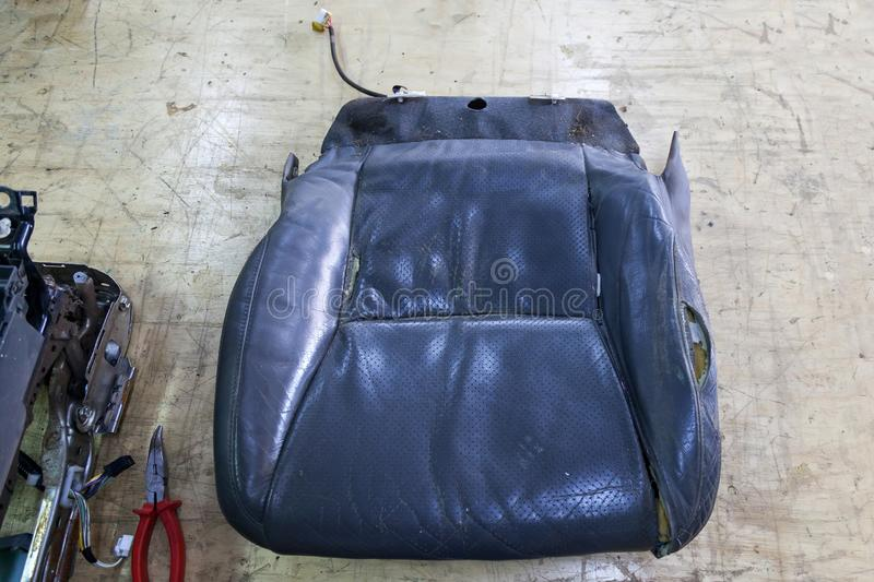 Leather Upholstery Repair >> An Old Car Seat Made From Tattered And Torn Leather