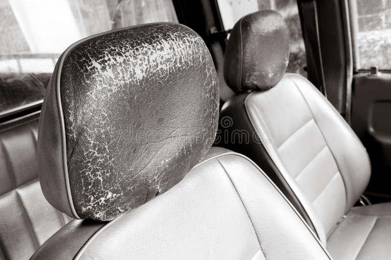 Old car seat. Two Black Old car seat in cabin, leather surface have a Cracks or rough, add an Sepia color vintage effect to feel retro royalty free stock photos