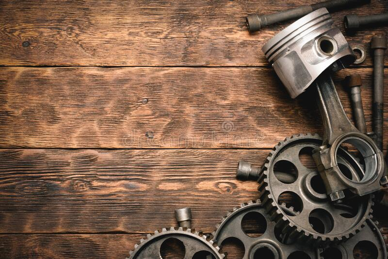 Old car spare parts. Old car spare parts on brown wooden workbench background with copy space royalty free stock photos