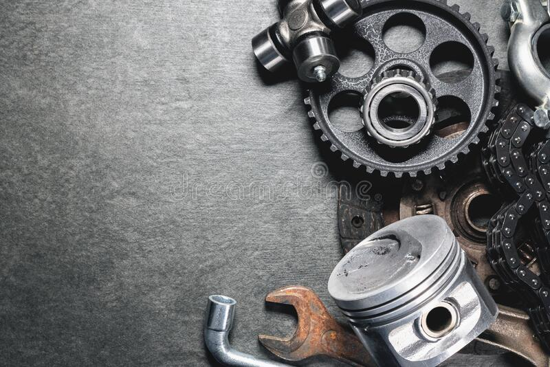 Car spare parts. Old car spare parts on gray background with copy space stock images