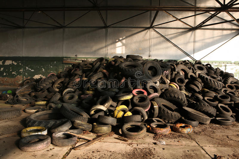 Old car tires in the area of the former Soviet military base in royalty free stock photo