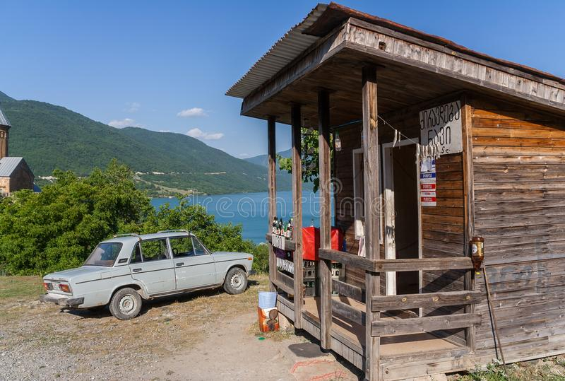 Old car and wooden food stall at the Aragvi River, Georgia. Old car and wooden food stall at the Aragvi River in Georgia stock images