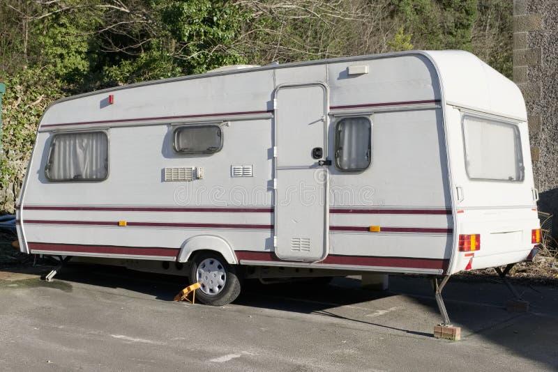 Old caravan dumped broken at roadside by travellers gypsies environmental pollution. Uk royalty free stock image