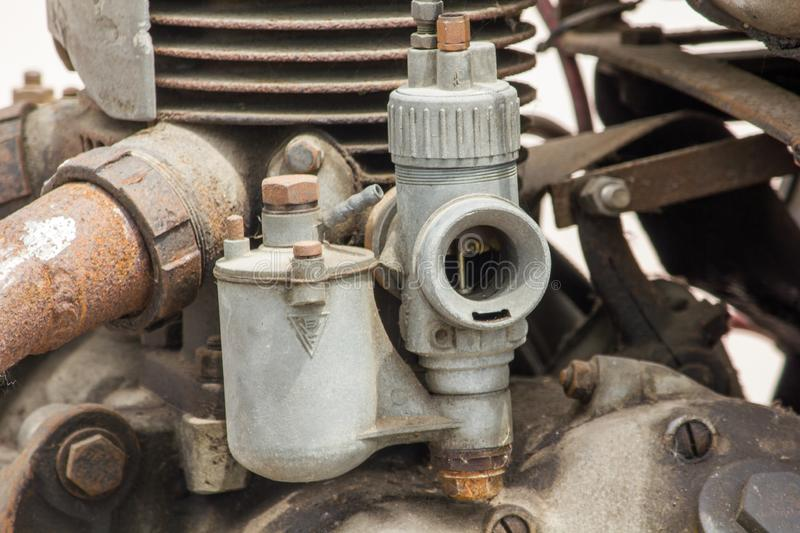 Old carburettor in the engine of an antique car stock photography