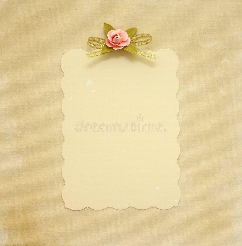 Old card with a flower design. Embellishment on vintage background stock image