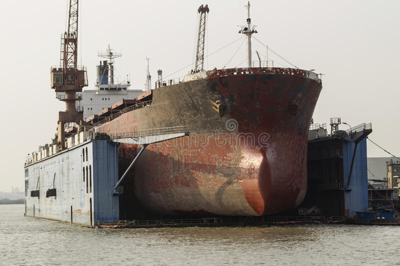 Old Cargo Ship under Maintenance stock photo