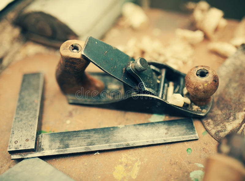 Old carpenter working with wood royalty free stock images