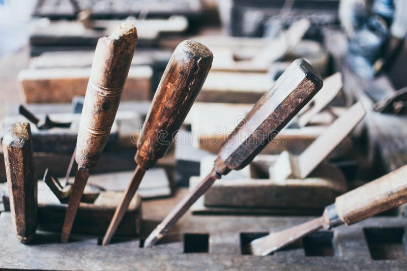Old carpentry tools in a wooden workshop royalty free stock images