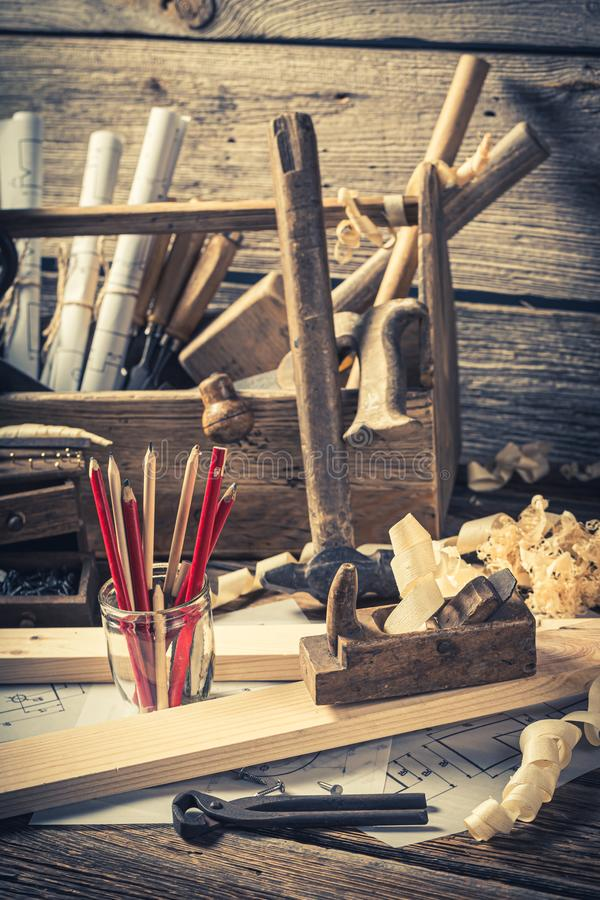 Old carpentry workbench and drawing workshop on rustic wooden table. Closeup of old carpentry workbench and drawing workshop on rustic wooden table royalty free stock images
