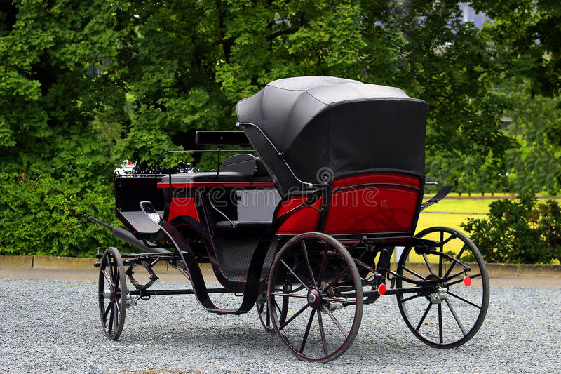 Old carriage, stagecoach pulled by horses stock image