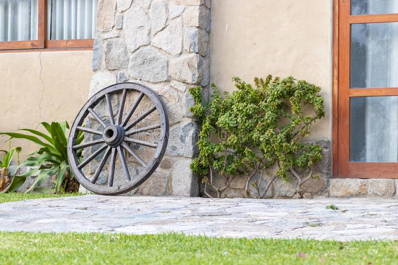 Old carriage wheel used as decoration stock photo