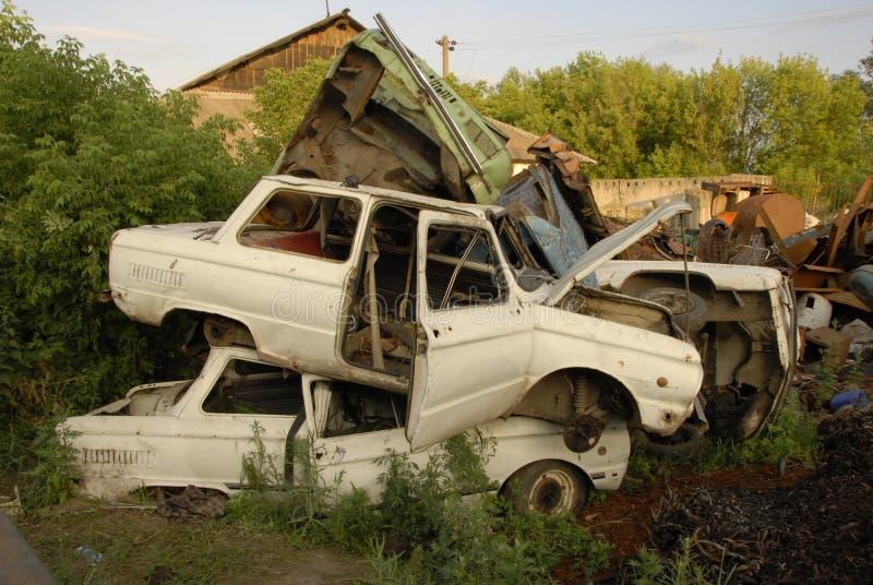 Old cars in junkyard stock photos