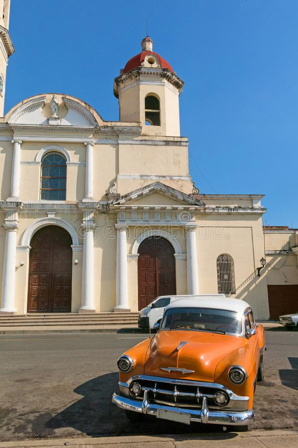 Old cars parked in the José Martí Park, in front of the Purisima Concepcion Cathedral. Cienfuegos, Cuba. Old cars parked in the José Martí Park, the royalty free stock image