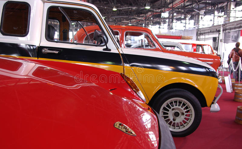 Old cars on red stage royalty free stock photo