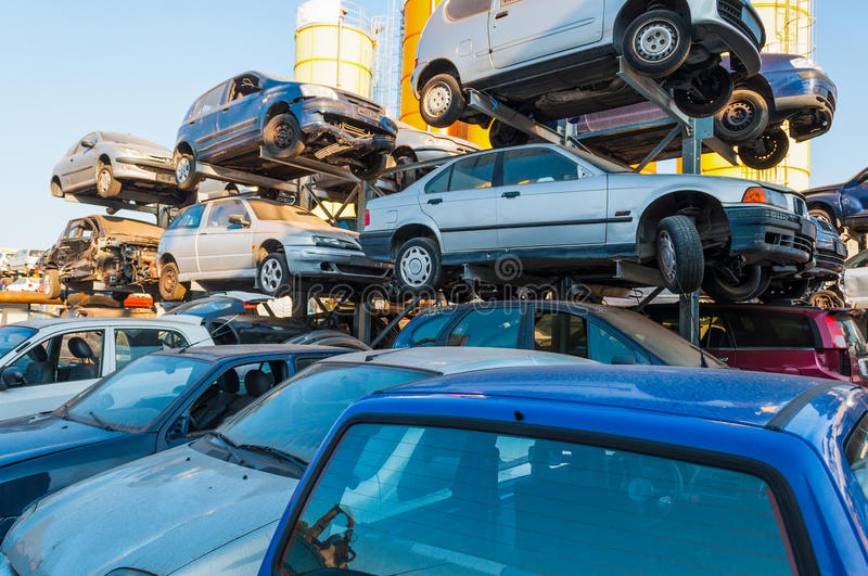 Cars stacked in a car breaker junkyard royalty free stock photo