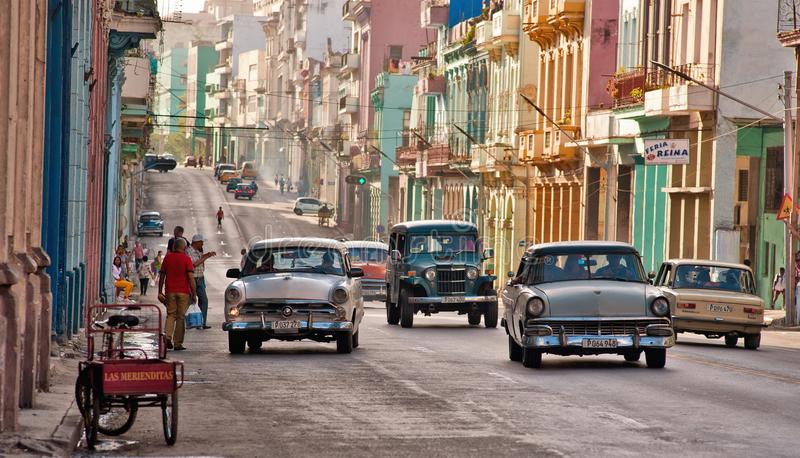 Old cars transiting in an avenue of Havana. Cuba royalty free stock photos