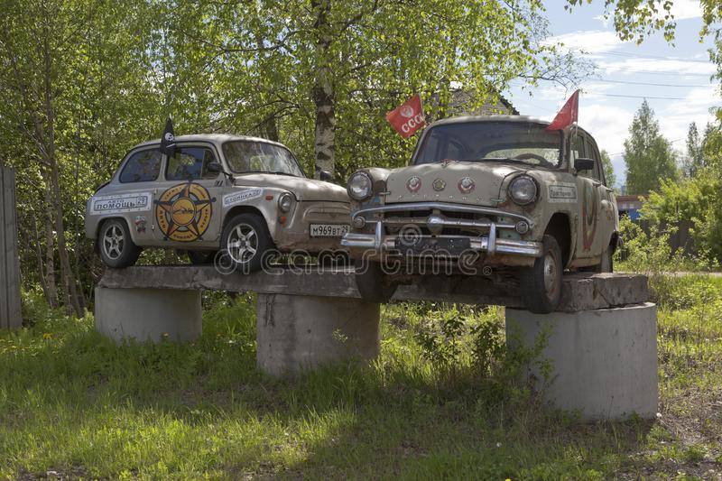 Old cars Zaporozhets and Moskvich on an improvised pedestal at a special parking on Traktornaya Street in the city of Velsk,. Velsk, Arkhangelsk Region, Russia royalty free stock image
