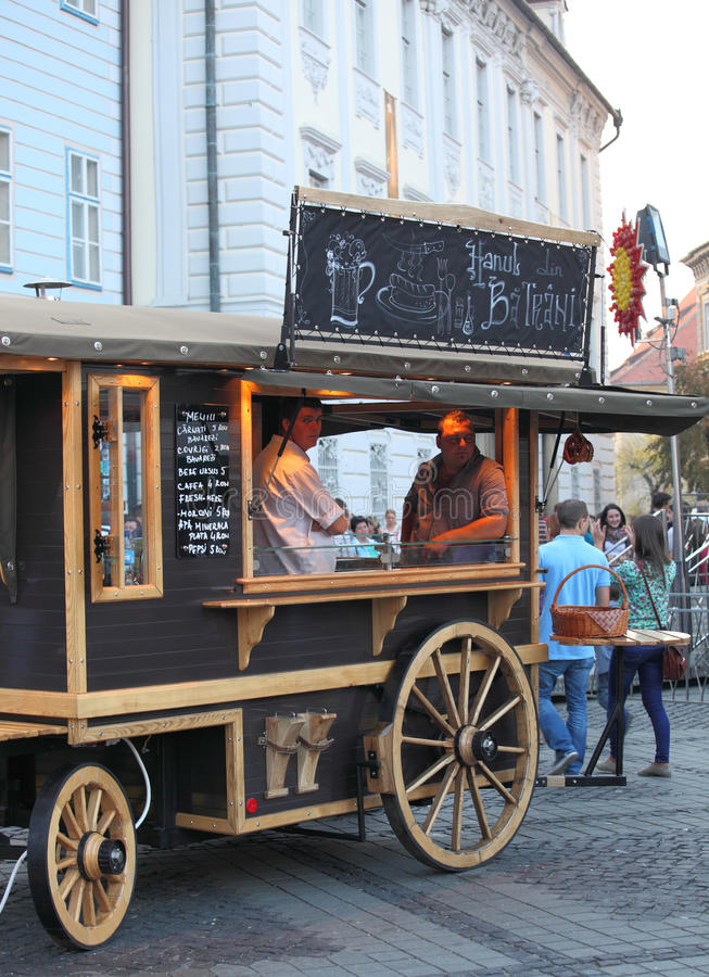 Old cart at CibinFest selling sausages. Sibiu, Romania - September 28, 2012: Old cart selling sausages in Large Square at CibinFest, the Romanian OktoberFest royalty free stock photo