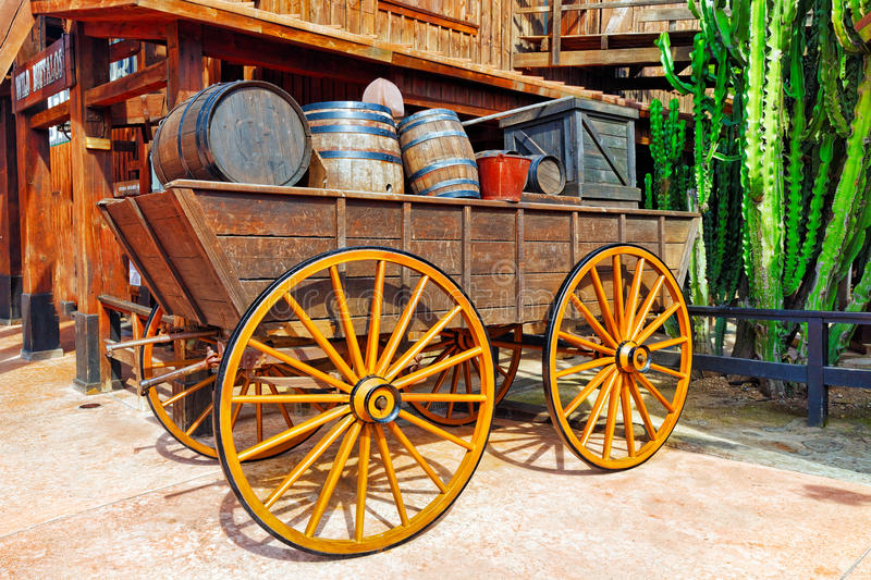 Old cart with wine barrels. Wild West stock photo