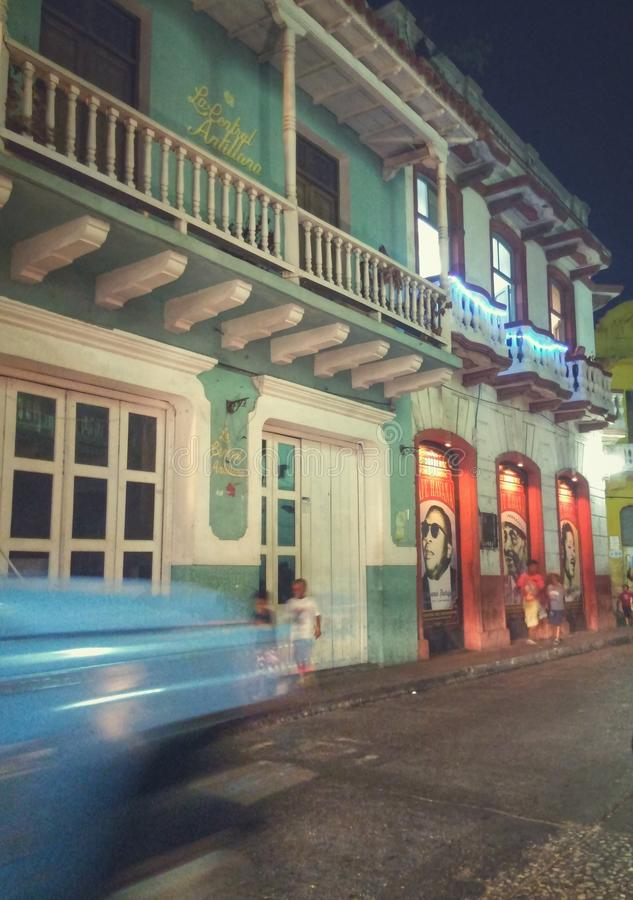Cartagena (Colombia) downtown night scape with blue car, aqua traditional house royalty free stock photo