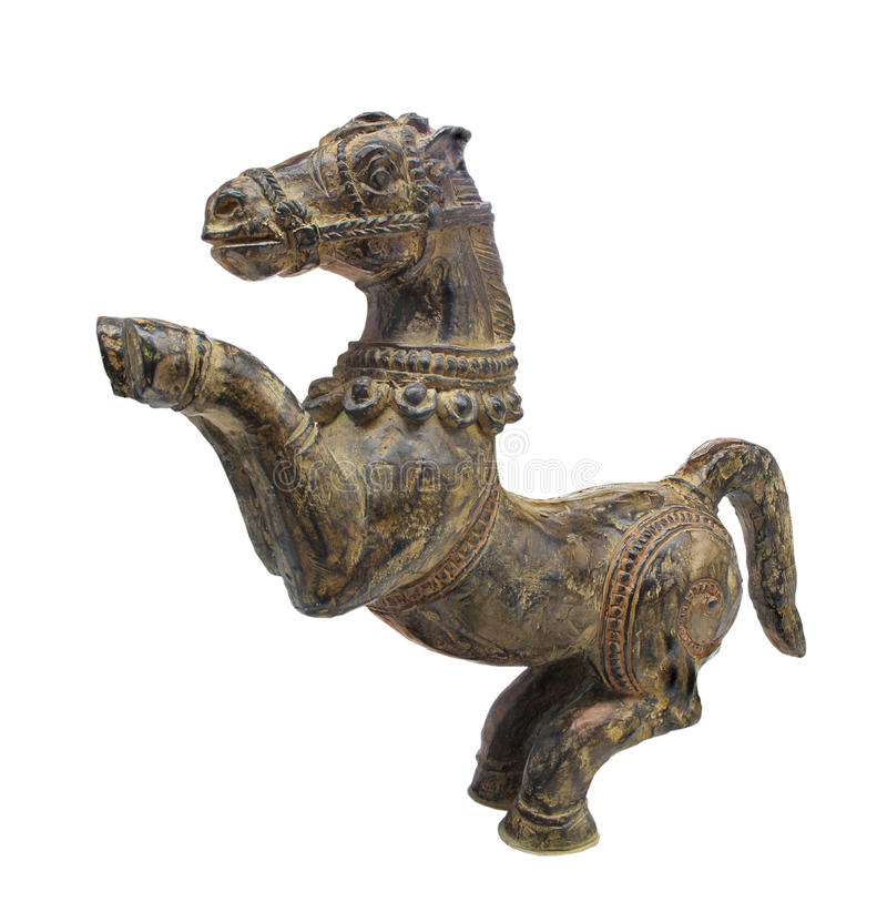 Old carved horse figure isolated. royalty free stock photo