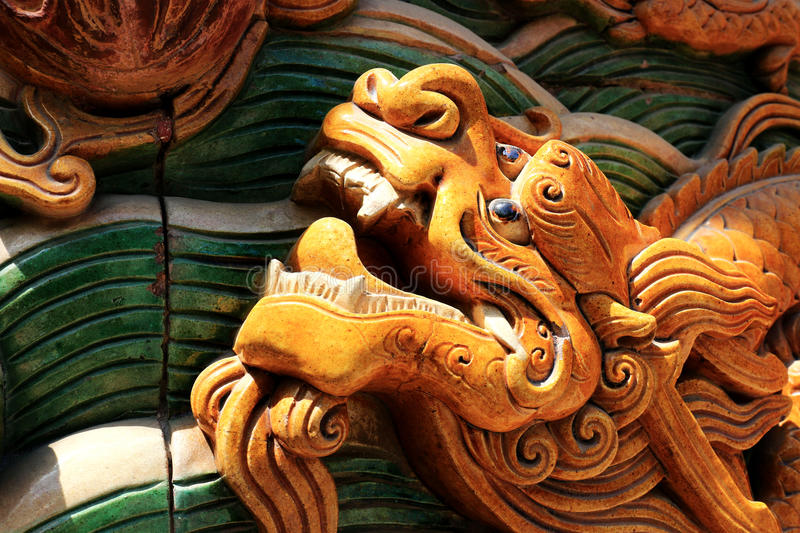 Old carved Long Chinese dragon in Beihai Park, Beijing stock image