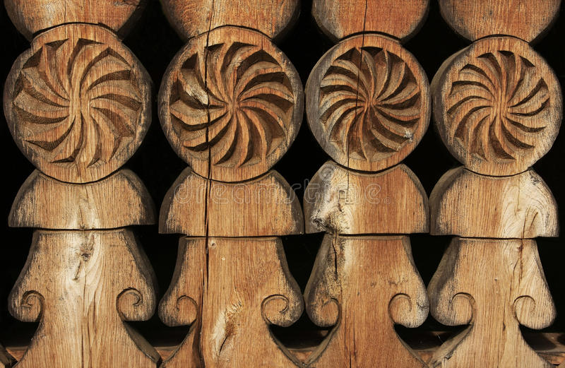 Old carved wood. Old carved in wood from a church exterior fence stock photo