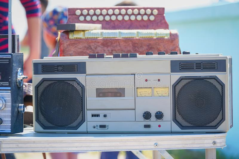 Old cassette recorder of silver color on table. Old cassette recorder of silver color on the table stock image