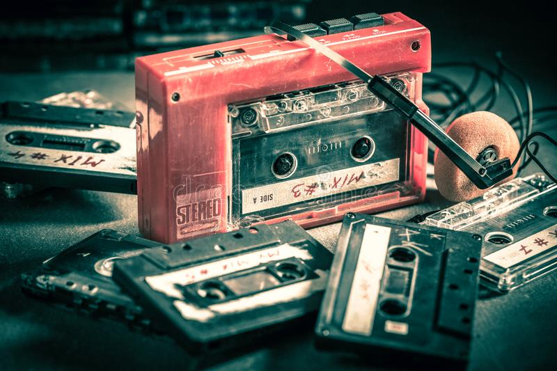 Old cassette tape with headphones and walkman royalty free stock image