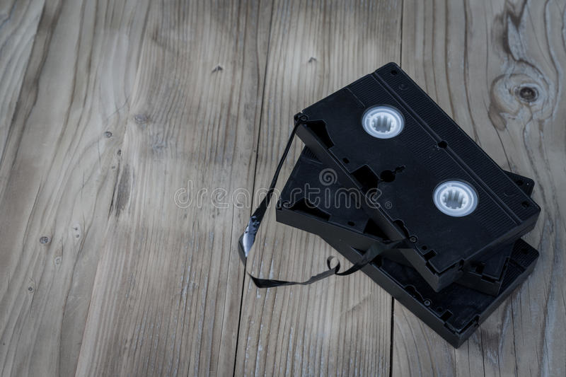 Old cassettes vhs video. Vintage view with old cassettes vhs video on wooden desk stock image