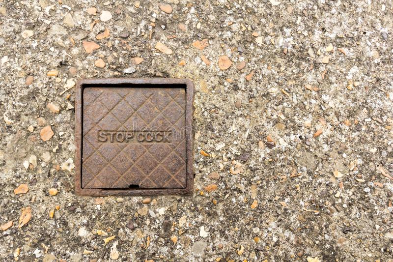 Stop Cover. Old cast iron stop cover - copy space provided stock photography