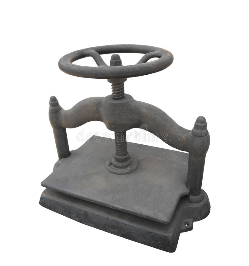 Old cast iron wheel turned book press isolated. stock photo