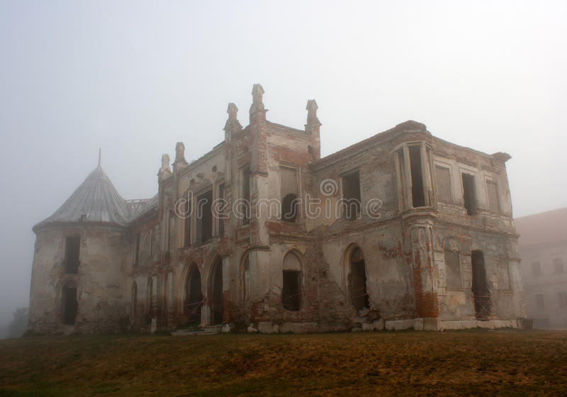 Old castle. The old Banfy Castle near Cluj Napoca, Romania. Picture was taken on a really foggy morning royalty free stock image