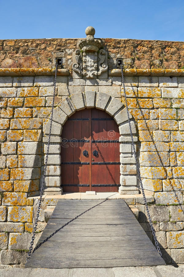 Old castle door and drawbridge. In Porto, Portugal royalty free stock image