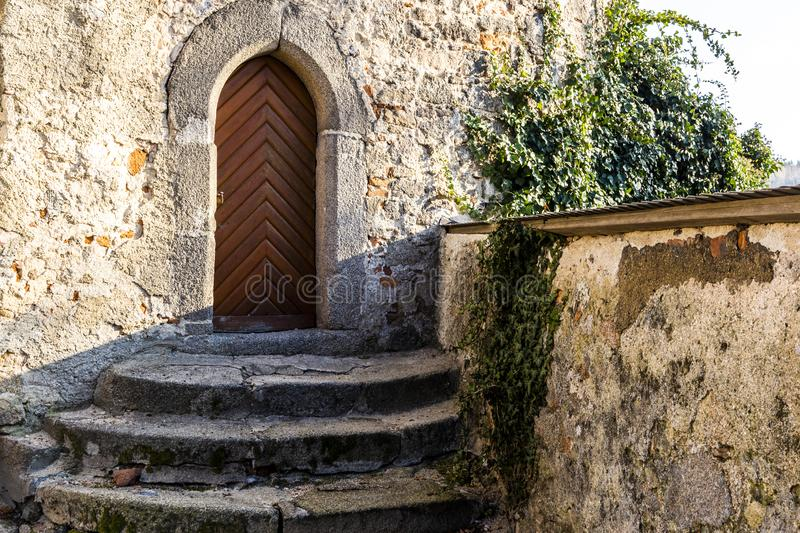 Old castle door. Gothic style stock image