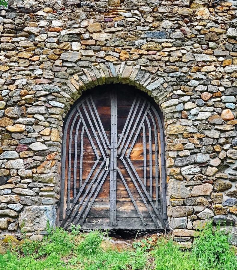 Old castle door. And stone wall royalty free stock image