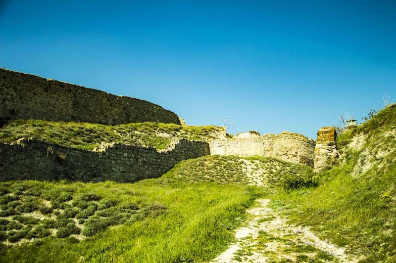The old castle on green hills stock images