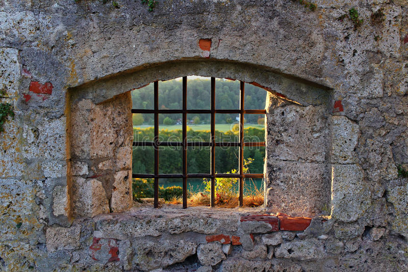 Old castle lattice window with view to fall landscape stock photo
