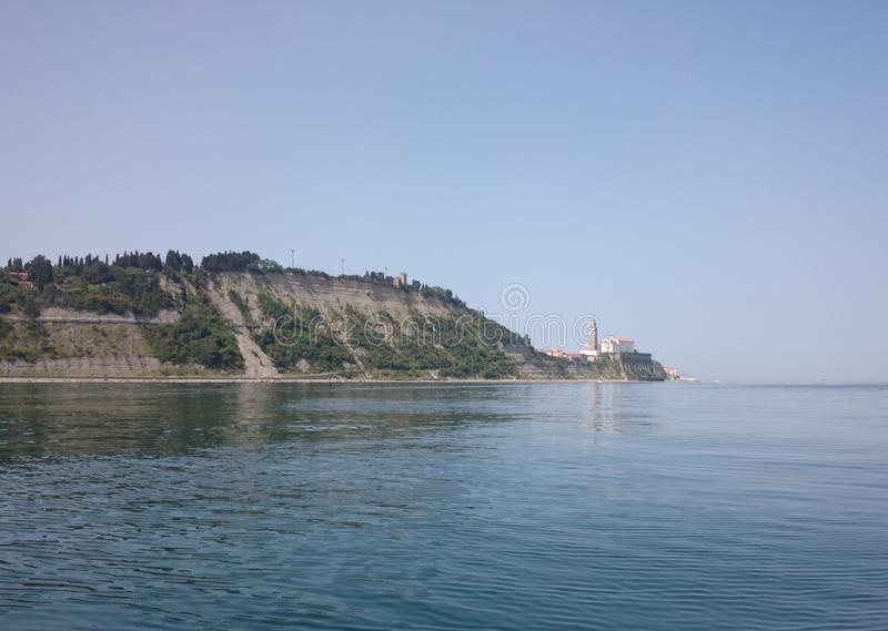 Old castle in piran taken from sea stock photography