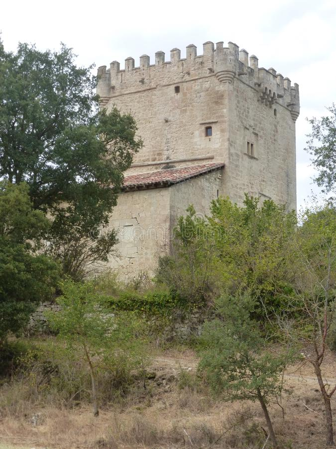 OLD DEFENSIVE TOWER IN QUINTANA DE VALDIVIELSO, BURGOS. OLD CASTLE IN QUINTANA DE VALDIVIELSO, BURGOS, SPAIN stock image