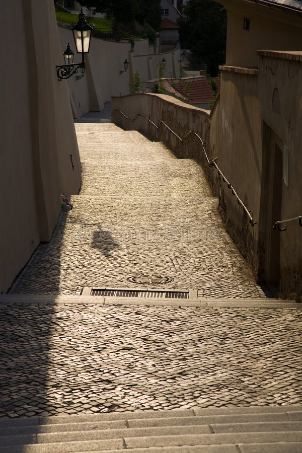 Old castle stairs. Prague Old castle stairs in morning sun stock images