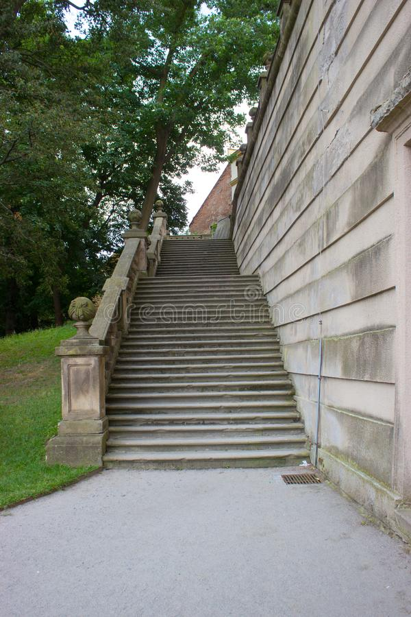 Old castle stairs and trees 2. Old castle stairs, path, wall grass and trees royalty free stock photo