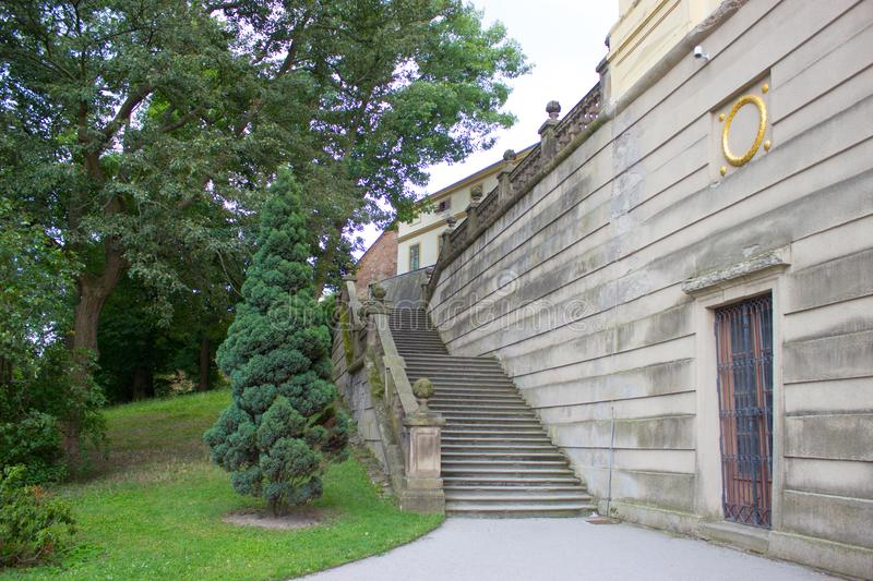 Old castle stairs and trees. Old castle stairs, path, door in the wall, and trees stock photo