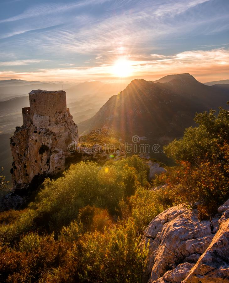Old Castle staring at Fall`s colors: Sunset taken in the French Cathare region the day before the last moon eclipse. royalty free stock images