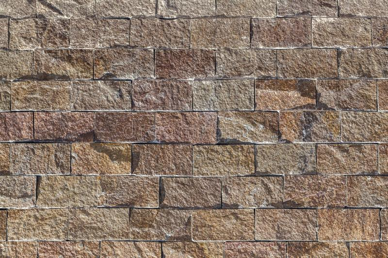 Old castle stone wall texture background. Brick backdrop. Brown color stock photography