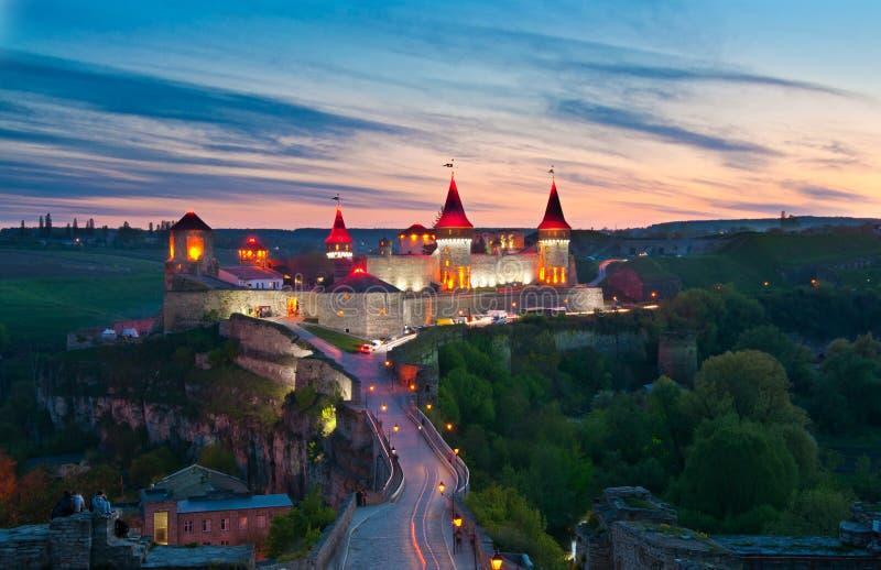 Old castle on the sunset, night light. Night light of old castle in Kamenetz-Podolsk in Ukraine royalty free stock photos