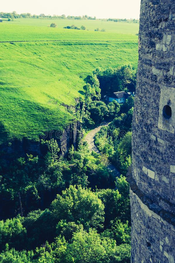 Old castle wall and green landscape stock photo