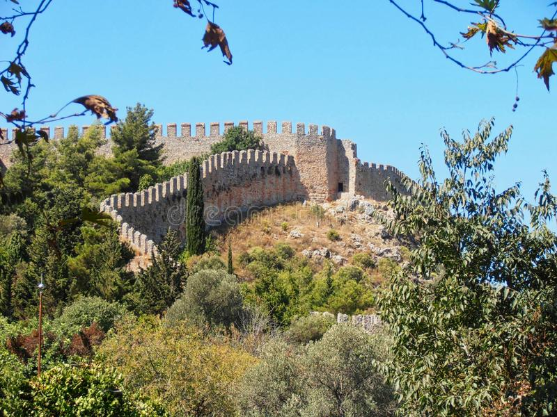 an old castle wall on the rock royalty free stock photos