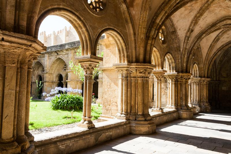 Old Cathedral cloister in Coimbra in summer. Coimbra is a city and a municipality in Portugal stock photos